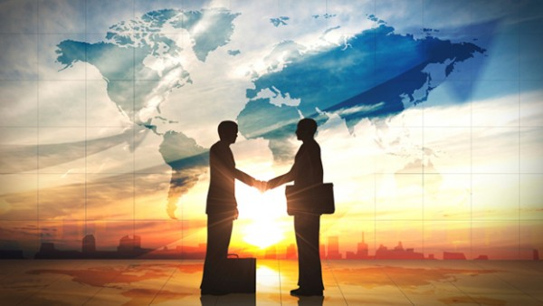 two-business-man-shake-hand-silhouettes-city-with-world-mapsv2